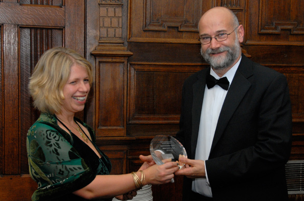 Yochai Benkler receives his Lifetime Achievement Award from OII Fellow Victoria Nash.